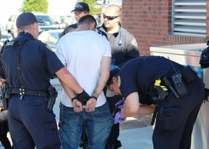Police search the man before taking him to Providence Regional Medical Center for an evaluation.