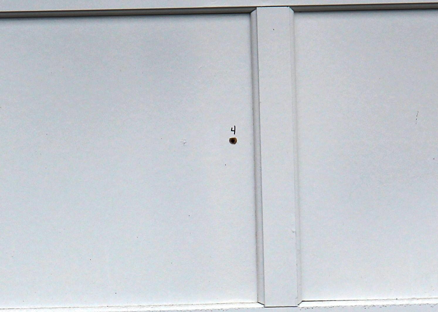 Drive by shootings rattle southwest everett neighborhood a bullet hole is visible in a garage door rubansaba